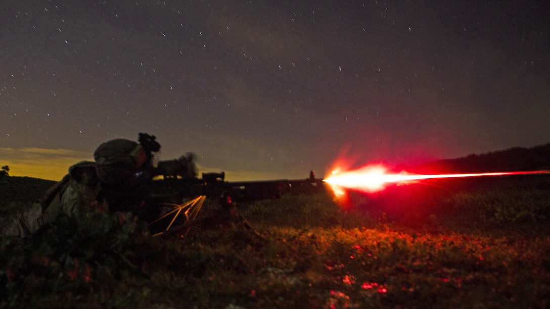 U.S. Marine Corps Lance Cpl. Charles Detz III, a machine-gunner with Special-Purpose Marine Air-Ground Task Force Crisis Response-Africa, fires a tracer round from an M240B during a live-fire training exercise in Sierra Del Retin, Spain, March 24, 2015. Marines stationed at Moron Air Base utilized the Spanish training facility to conduct a variety of training missions to maintain their infantryman skills.