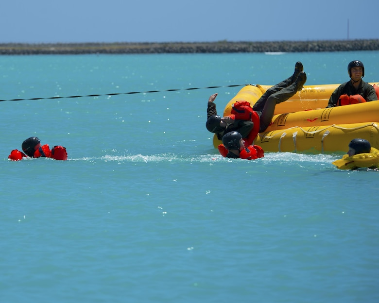 Airmen jump into Hickam Harbor to simulate exiting an aircraft that has landed in the ocean during water survival training March 23, 2015, at Joint Base Pearl Harbor-Hickam, Hawaii. Water survival training is completed on triennial basis for all aircrew assigned to the 15th Wing. The Airmen participating in the training were from the 535th Airlift Squadron, 65th Airlift Squadron and the 96th Air Refueling Squadron. (U.S. Air Force photo/Tech. Sgt. Aaron Oelrich)