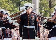 The U.S. Marine Corps Silent Drill Platoon performs during a Battle Color Ceremony at Liversedge Field, Camp Lejeune, N.C., March 24, 2015. The ceremony featured the Drum and Bugle Corps, the Silent Drill Platoon and the Marine Corps Color Guard. (U.S. Marine Corps photo by Cpl. Carolyn P. Pichardo, MCI-East Combat Camera/Released)