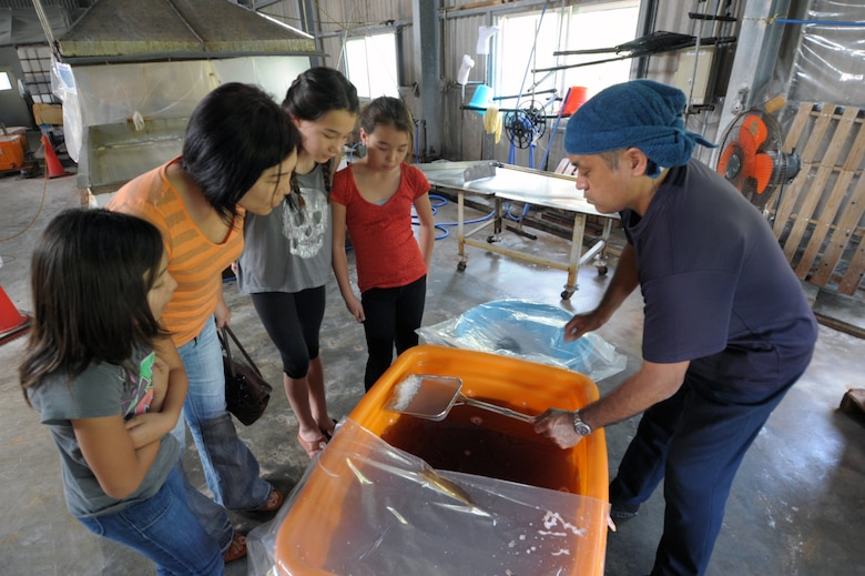 Masaru Takaesu explains the process for harvesting salt at his factory on Hamahiga Island during a March 22, 2015, tour. Hamahiga Island, about a 25-minute drive from Kadena Air Base, Japan, offers a couple of free sightseeing locations, including the Takaesu Salt Factor. (U.S. Air Force photo by Tim Flack)
