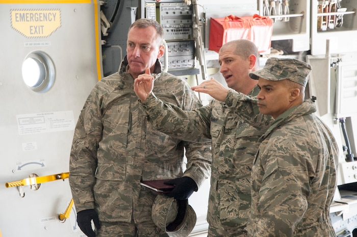 Senior Master Sgt. Brian Denny, Air Force Mortuary Affairs Operations superintendent (center), briefs Col. Daniel F. Merry, AFMAO commander, and Chief Master Sgt. Rabin Ramsook, AFMAO chief enlisted manager, about some of the behind-the-scene details during a dignified transfer divert exercise March 19, 2015, at New Castle Air National Guard Base, Del. The exercise involved 60 total force members executing a contingency DT plan at an alternate location. (U.S. Air Force photo/Senior Airman Jared Duhon)