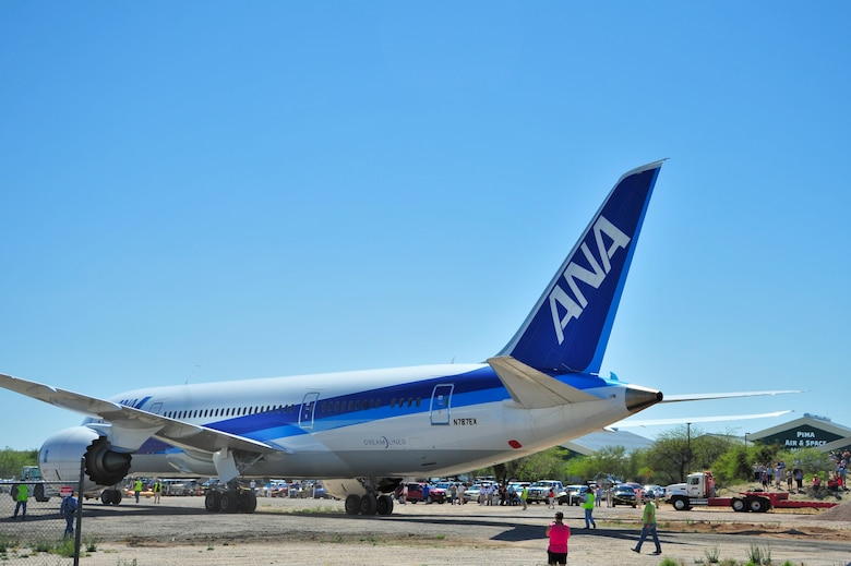 Spectators watch as a Boeing 787-8 Dreamliner is towed into the entrance of Pima Air & Space Museum after landing and defueling at Davis-Monthan Air Force Base, Ariz., March 26, 2015.  This 787-8 Dreamliner, the second prototype of its kind produced, was donated to the museum.  (U.S. Air Force photo by Airman 1st Class Chris Massey/Released)