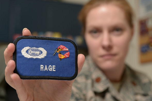 U.S. Air Force Maj. Victoria Williams, the 354th Fighter Wing senior intelligence officer, displays one of her unit patches at Eielson Air Force Base, Alaska, March 26, 2015. Williams advises the wing commander and senior leaders on any threats to their forces at home or deployed and manages intelligence professionals assigned to the wing. (U.S. Air Force photo by Senior Airman Peter Reft/Released)¬¬¬¬