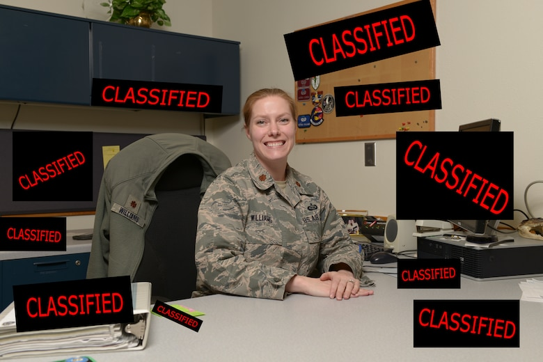 U.S. Air Force Maj. Victoria Williams, the 354th Fighter Wing senior intelligence officer, takes a quick break from work at Eielson Air Force Base, Alaska, March 26, 2015. Williams advises the wing commander and senior leaders on any threats to their forces at home or deployed and manages intelligence professionals assigned to the wing. (U.S. Air Force photo illustration by Senior Airman Peter Reft/Released) (This image was manipulated by adding boxes and text to original image)