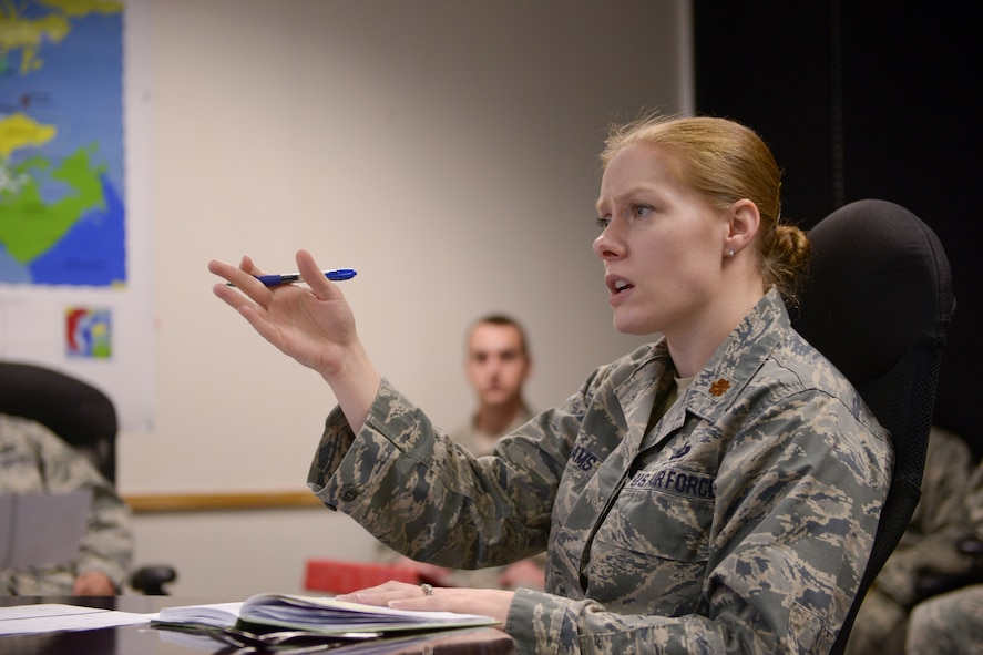 U.S. Air Force Maj. Victoria Williams, the 354th Fighter Wing senior intelligence  officer, holds a training session with her Airmen at Eielson Air Force Base, Alaska, March 26, 2015. Williams enhanced her Airmen's capability to communicate information properly to audience members. (U.S. Air Force photo by Senior Airman Peter Reft/Released)