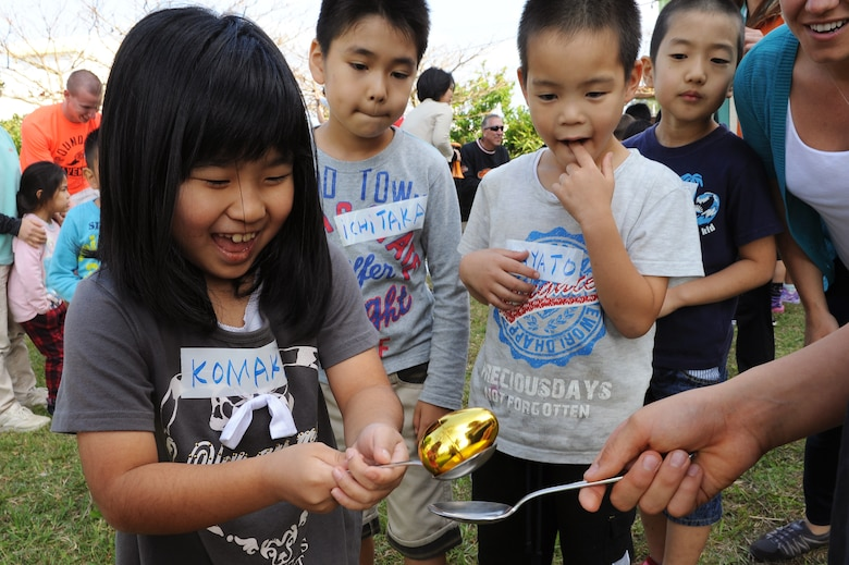 A child from the Midori School-Age Program transfers a plastic egg from one spoon to another during a relay race in Okinawa City, Japan, March 26, 2015. The relay race was one of several games and activities set up for local children by members of the Wisconsin Air National Guard's 115th Fighter Wing. (U.S. Air Force photo by Airman 1st Class Zade C. Vadnais)
