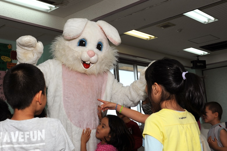 The Easter Bunny surprises children from the Midori School-Age Program in Okinawa City, Japan, March 26, 2015. Members from the Wisconsin Air National Guard 115th Fighter Wing organized a visit to the center in order to interact with the local community during their time on the island. (U.S. Air Force photo by Airman 1st Class Zade C. Vadnais)