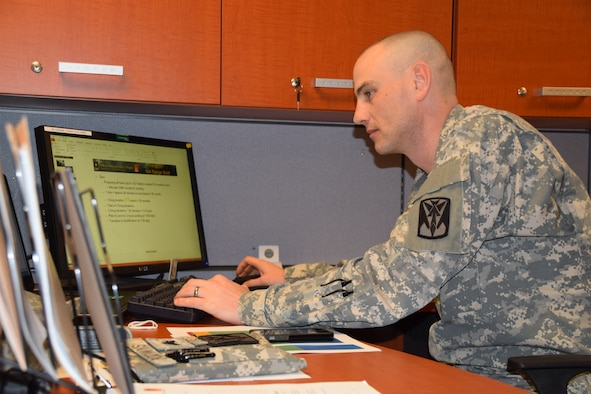 Sgt. Jerimey Podwys, 35th Air Defense Artillery Brigade senior Local Area Network manager, establishes new user accounts for Soldiers recently assigned to the brigade March 30, 2015 at Osan Air Base, Republic of Korea.