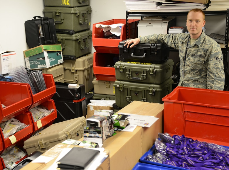 Senior Airman Kyle McCollum, AFRC Yellow Ribbon logistics manager, stands among hundreds of itiems in a storage room at Robins Air Force Base, Ga., that he must inventory and ship to Yellow Ribbon events. (Air Force photo/Master Sgt. Chance Babin)