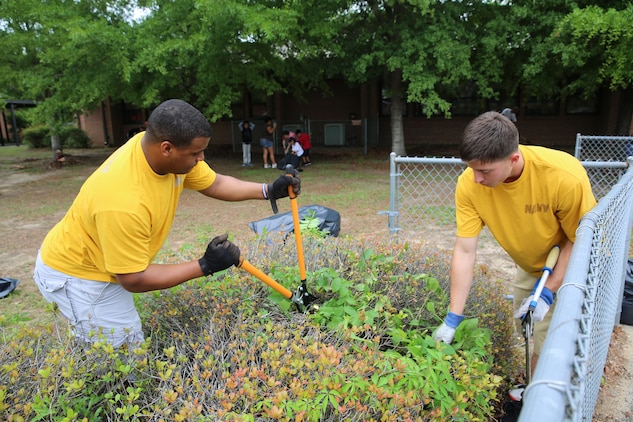 Stepping up and lending a hand goes a long way for the community. Marines, sailors, teachers, parents and children volunteered to help beautify the grounds at Galer Elementary School, April 20.