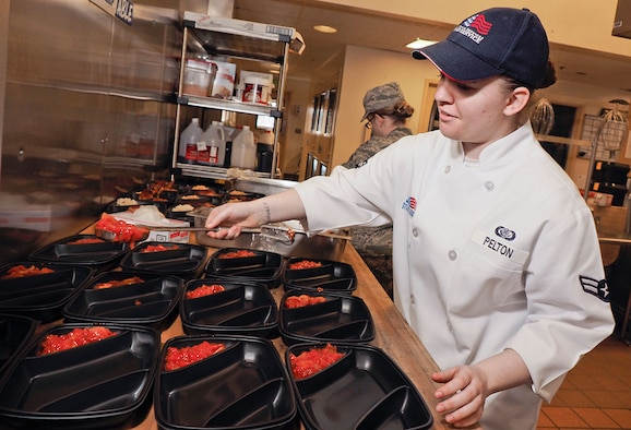 Airman 1st Class Cortny Pelton, assigned to 673rd Force Support Squadron, prepares food for lunch at the Iditarod Dining Facility April 23, 2015, on Joint Base Elmendorf-Richardson, Alaska. Pelton, a native of Wyoming, Mich., and the rest of the 673rd FSS, earned the Air Force Curtis E. LeMay award for best large installation-level FSS of the year in the Air Force for 2014. (U.S. Air Force photo/Justin Connaher)