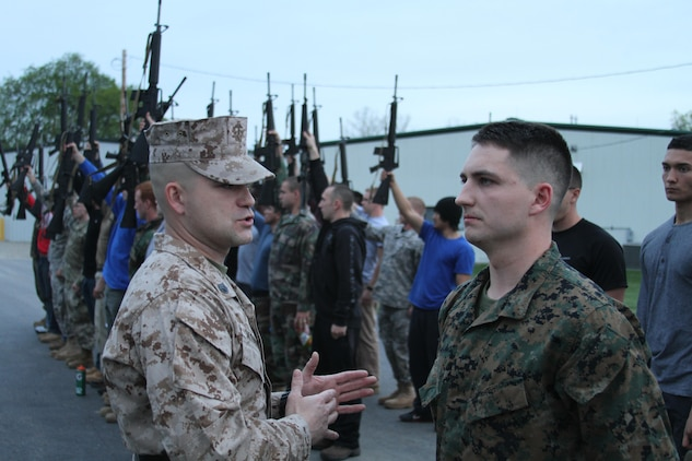 U.S. Marine Corps Staff Sgt. Paris Skidmore, a sergeant instructor at Officer Candidates School at Marine Corps Base Quantico, Virginia, instructs his squad on how to get accountability while in a formation, at Camp Sherman Joint Training Center in Chillicothe, Ohio, April 25, 2015. Candidates endured many physical and mental challenges during their mini OCS such as limited sleep and long days filled with land navigation, combat maneuvers and leadership development. (U.S. Marine Corps photo by Cpl. Kyle Welshans/Released)