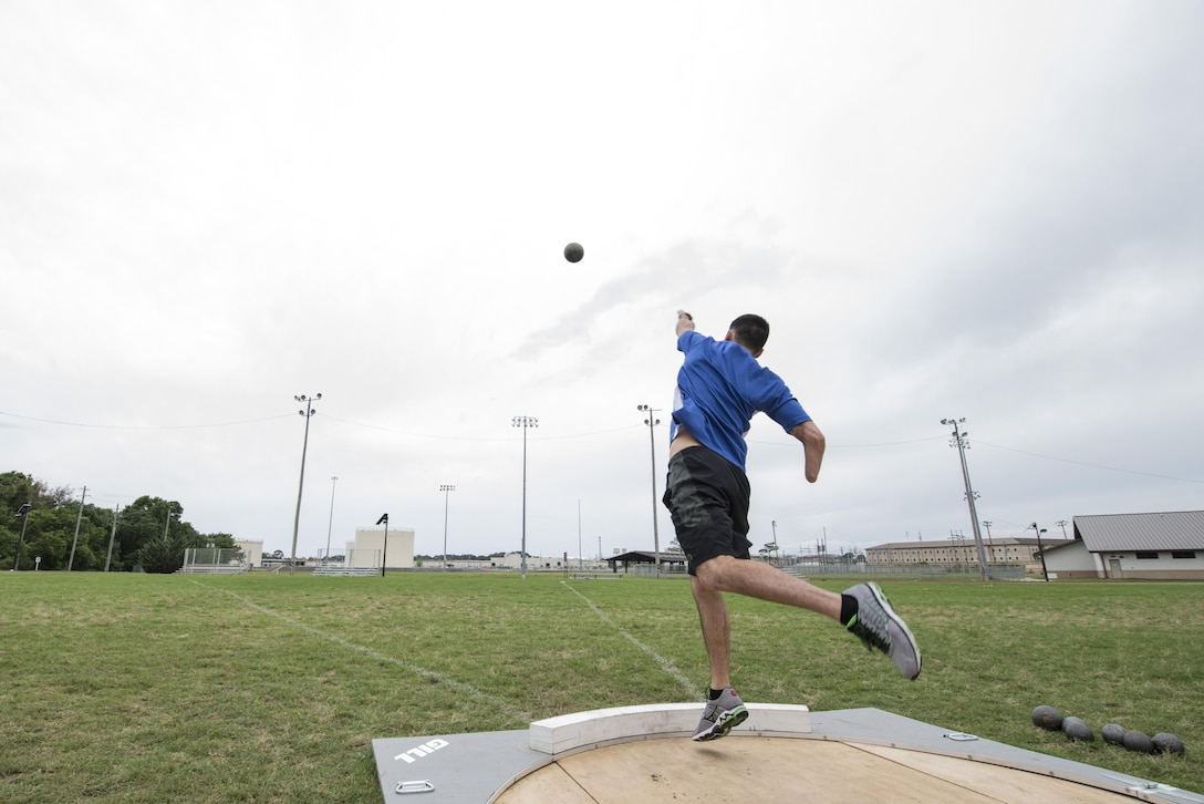 Retired Staff Sgt. Daniel Crane, an Air Force wounded warrior athlete, throws a shot put during the Air Force's Warrior Games training camp at Eglin Air Force Base, Fla., April 20, 2015. The training camps, hosted by the U.S. Air Force Wounded Warrior Program in coordination with Brig. Gen. David Harris, the 96th Test Wing commander, assisted in recovery and promoted mental and physical health, as well as teamwork. (U.S. Air Force photo/Maureen Stewart)