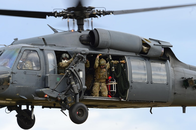 Pararescuemen assigned to Royal Air Force Lakenheath's 57th Rescue Squadron prepare to rappel from an HH-60G Pave Hawk during exercise Joint Warrior 15-1 in Scotland, April 22, 2015. The exercise tested the ability of armed forces from various countries to synchronize during worldwide operations. (U.S. Air Force photo/Senior Airman Erin O'Shea)