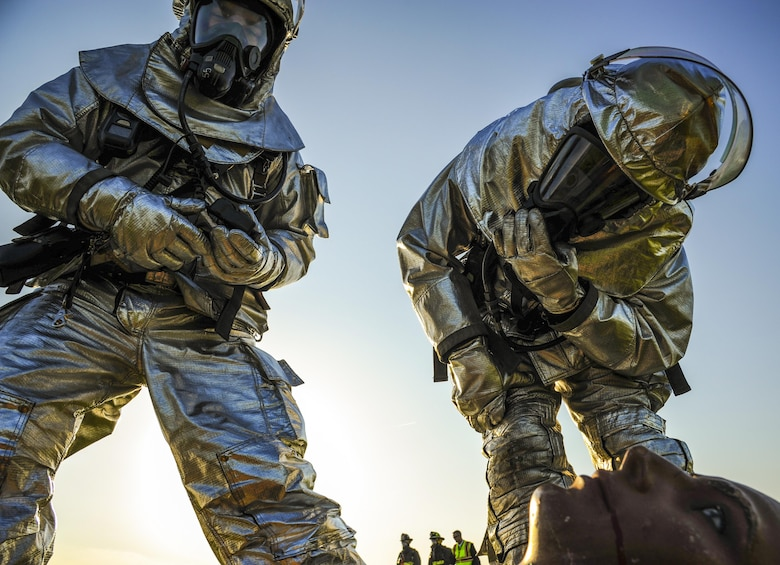 Staff Sgt. Nathan Williams and Senior Airman Justin Caldwell, 19th Civil Engineer Squadron firefighters, inspect a simulated casualty as part of a major accident response inspection April 22, 2015, in Jacksonville, Ark. The exercise replicated an aircraft accident and tested the readiness of Airmen from more than five different Little Rock Air Force Base squadrons. (U.S. Air Force photo/Senior Airman Harry Brexel)