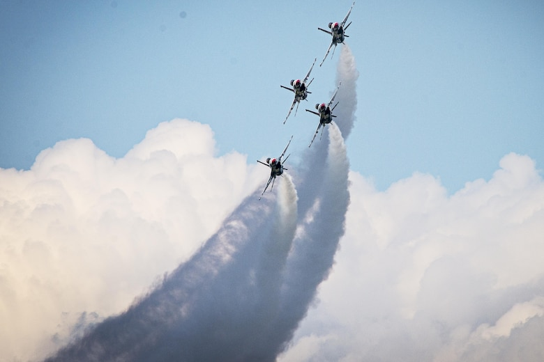 The Thunderbirds' Thunder Diamond formation performs the Diamond Bottom Up Pass maneuver during a practice show at Lakeland, Fla., April 24, 2015. (U.S. Air Force photo/Tech. Sgt. Manuel J. Martinez)