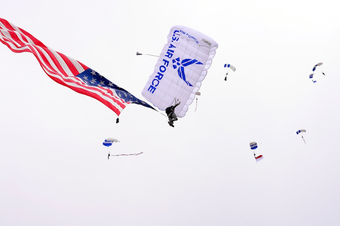 The Wings of Blue parachute team jumps from an MC-130 to land on the U.S. Air Force Academy's Terrazzo in Colorado Springs, Colo., April 24, 2015. Two CV-22 Ospreys assigned to the 71st Special Operations Squadron, 58th Special Operations Wing, then landed on the Terrazzo as part of an Air Force Special Operations Command demonstration in support of the yearly cadet exercise Polaris Warrior. (Air Force photo/Mike Kaplan)