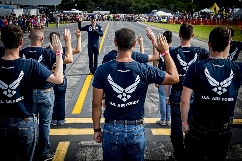 Maj. Tyler Ellison, a Thunderbirds pilot, administers the Oath of Enlistment to enlist Florida's newest Airmen during the Sun 'n Fun International Fly-in and Expo Air Show at Lakeland, Fla., April, 25, 2015. (U.S. Air Force photo/Tech. Sgt. Manuel J. Martinez)