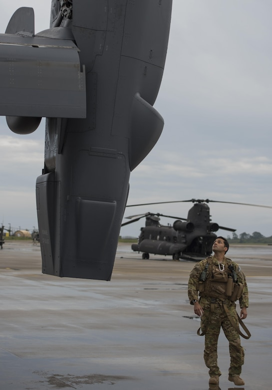 An 8th Special Operations Squadron pilot completes pre-flight checks on a CV-22 Osprey during Emerald Warrior 2015 at Hurlburt Field, Fla., April 27, 2015. The primary mission of the 8th SOS is insertion, extraction and resupply of unconventional warfare forces and equipment into hostile or enemy-controlled territory using airland or airdrop procedures. Emerald Warrior is the Defense Department's only irregular warfare exercise, allowing joint and combined partners to train together and prepare for real-world contingency operations. (U.S. Air Force photo/Staff Sgt. DeAndre Curtiss)