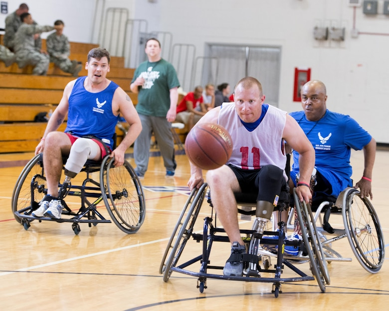 Benjamin Seekell, an Air Force wounded warrior athlete, hustles for the fast break during the adaptive sports and rehabilitation camp at Eglin Air Force Base, Fla., April 20, 2015. The Air Force Wounded Warrior Program uses adaptive sport to enhance warrior recovery by engaging wounded, ill and injured service members in ongoing, daily adaptive activities based on their interest and ability. (U.S. Air Force photo/Brandon DeLoach)
