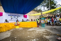 U.S. Navy Capt. James Meyer, commodore of the 30th Naval Construction Regiment, speaks to the members of the community about the work put into the Sabang Elementary School as part of the ribbon cutting ceremony in Puerto Princesa, Philippines, during exercise Balikatan 2015, April 28. The ribbon cutting ceremony was chance for members of the community and military come together and celebrate the recently finished classroom. Balikatan provides an opportunity for Philippine and U.S. forces to continue strengthening relationships and work together.