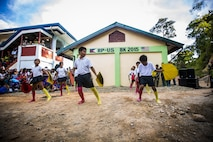 Students of the Sabang Elementary School perform a dance before the ribbon cutting ceremony for the school's new classroom in Puerto Princesa, Philippines, during exercise Balikatan 2015, April 28. The ribbon cutting ceremony was chance for members of the community and military come together and celebrate the recently finished classroom. Balikatan provides an opportunity for Philippine and U.S. forces to continue strengthening relationships and work together.