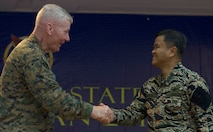 "U.S. Marine Lt. Gen John A. Toolan, left, commander, U.S. Marine Corps Forces, Pacific and U.S. exercise director for Balikatan 2015, shakes hands with Armed Forces of the Philippines Vice Adm. Alexander S. Lopez, AFP exercise director for BK15, during the exercise's closing ceremony at Clark Air Base, Philippines, April 30. Balikatan, which means ""shoulder-to-shoulder"" in Filipino, is an annual bilateral training exercise between U.S. and Philippine forces improving security cooperation activities, humanitarian assistance and disaster relief capabilities, and crisis response throughout the region."