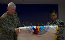 "U.S. Marine Lt. Gen John A. Toolan, left, commander, U.S. Marine Corps Forces, Pacific and U.S. exercise director for Balikatan 2015, and Armed Forces of the Philippines Vice Adm. Alexander S. Lopez, AFP exercise director for BK15, furl the Balikatan flag signifying the close of the exercise during the closing ceremony at Clark Air Base, Philippines, April 30. Balikatan, which means ""shoulder-to-shoulder"" in Filipino, is an annual bilateral training exercise between U.S. and Philippine forces improving security cooperation activities, humanitarian assistance and disaster relief capabilities, and crisis response throughout the region."