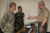 U.S. Marine Lt. Gen. John A. Toolan, Balikatan 2015 U.S. exercise director, speaks with U.S. Navy Lt. Douglas Pan, U.S. Humanitarian Civil Assistance Representative BK15, and Armed Forces of the Philippines Army Lt. Col. Rolando Gomez, Exercise Directorate Headquarters Staff for Intelligence BK15, about their roles and performance in the joint operation center during the exercise at Camp Aguinaldo, Quezon City, Philippines, April 28. The exercise provides an opportunity for Philippine, Australian and U.S. forces to continue strengthening relationships and work together to enhance combined capabilities.