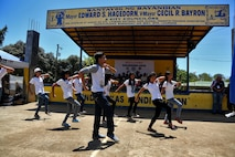 Teenagers dance during a ribbon cutting and turnover of school buildings ceremony at Santa Lordes High School in Puerto Princesa, on the island of Palawan, Philippines, April 29. The construction was part of humanitarian and civic action projects during exercise Balikatan 2015. This year marks the 31st iteration of the exercise, which is an annual Philippines-U.S. military bilateral training exercise and humanitarian civic assistance engagement.