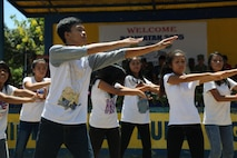 Teenagers dance during a ribbon cutting and turnover of school buildings ceremony at Santa Lordes High School in Puerto Princesa, on the island of Palawan, Philippines April 29.  The construction was part of humanitarian and civic action projects during exercise Balikatan 2015. This year marks the 31st iteration of the exercise, which is an annual Philippines-U.S. military bilateral training exercise and humanitarian civic assistance engagement.