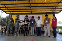 Armed Forces of the Philippines and U.S. service members hand over a symbolic key to school leadership during a ribbon cutting and turnover of school buildings ceremony at Santa Lordes High School in Puerto Princesa, on the island of Palawan, Philippines, April 29.  The construction was part of humanitarian and civic action projects during exercise Balikatan 2015. This year marks the 31st iteration of the exercise, which is an annual Philippines-U.S. military bilateral training exercise and humanitarian civic assistance engagement.