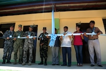 Leadership from the school, Armed Forces of the Philippines and U.S. service members cut the ribbon during a ribbon cutting and turnover of school buildings ceremony at Santa Lordes High School in Puerto Princesa, on the island of Palawan, Philippines, April 29. The construction was part of humanitarian and civic action projects during exercise Balikatan 2015. This year marks the 31st iteration of the exercise, which is an annual Philippines-U.S. military bilateral training exercise and humanitarian civic assistance engagement.