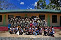 Civilians, Armed Forces of the Philippines and U.S. service members pose for a photograph during a ribbon cutting and turnover of school buildings ceremony at Santa Lordes High School in Puerto Princesa, on the island of Palawan, Philippines, April 29.  The construction was part of humanitarian and civic action projects during exercise Balikatan 2015. This year marks the 31st iteration of the exercise, which is an annual Philippines-U.S. military bilateral training exercise and humanitarian civic assistance engagement.