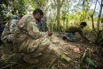 Philippine Marine Cpl. Jason Tallud with Battalion Landing Team 4, 3rd Marine Brigade, shows U.S. Army Staff Sgt. Jerome Holland, a combat medic with Civil Affairs Team 742, Delta Company, 97th Civil Affairs Battalion, how to make a snare trap during jungle survival training in Puerto Princesa, on the island of Palawan, Philippines, during exercise Balikatan 2015, April 28. The jungle survival training, taught by the Philippine Marine Corps, was held to instruct military members as well as practice techniques to become more effective when adapting to ones surroundings.