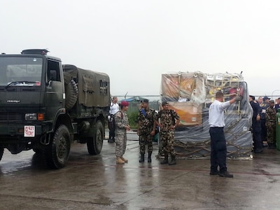 TRIBHUVAN, Nepal (Apr. 29, 2015) - The U.S. Civil Military Support Element (CMSE) Nepal coordinates with Nepalese Army soldiers at Tribhuvan International Airport to use Nepalese Army trucks to move search and rescue equipment that arrived in Nepal. A CMSE is a U.S. military civil affairs team which assists the U.S. Ambassador with civil-military programs and projects that support U.S. and host-nation objectives.