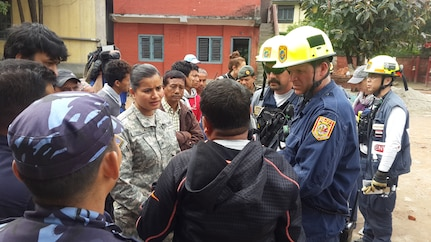 Nepal (Apr. 29, 2015) - A member of the U.S. Civil Military Support Element (CMSE) Nepal talks with USAID Disaster Assistance Response Team (DART) Search and Rescue team from Fairfax County, VA. The CMSE arranged for the SAR team to meet with the Deputy Superintendent Police for Bhaktapur to better synchronize search and rescue efforts.