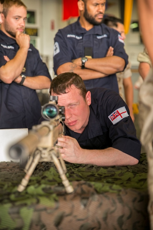 British Royal Navy Petty Officer Marine Engineer Elliott Watson, refrigeration engineer with the HMS Lancaster, looks through the scope of an M40A5 sniper rifle during a tour aboard the amphibious assault ship USS Wasp (LHD 1) while out at sea April 30, 2015. U.S. Marines and U.S. Navy Sailors with the 22nd Marine Expeditionary Unit from Marine Corps Base Camp Lejeune, N.C., participated in Navy Week 2015 in New Orleans April 23-29 and Fleet Week Port Everglades, Fla., May 4-10. The purpose of Navy Week was to showcase the strength and capabilities of the Navy-Marine Corps team through tours, static displays and community relations events, providing the public the opportunity to meet and interact with Marines and Sailors. (U.S. Marine Corps photo by Sgt. James R. Smith/Released)
