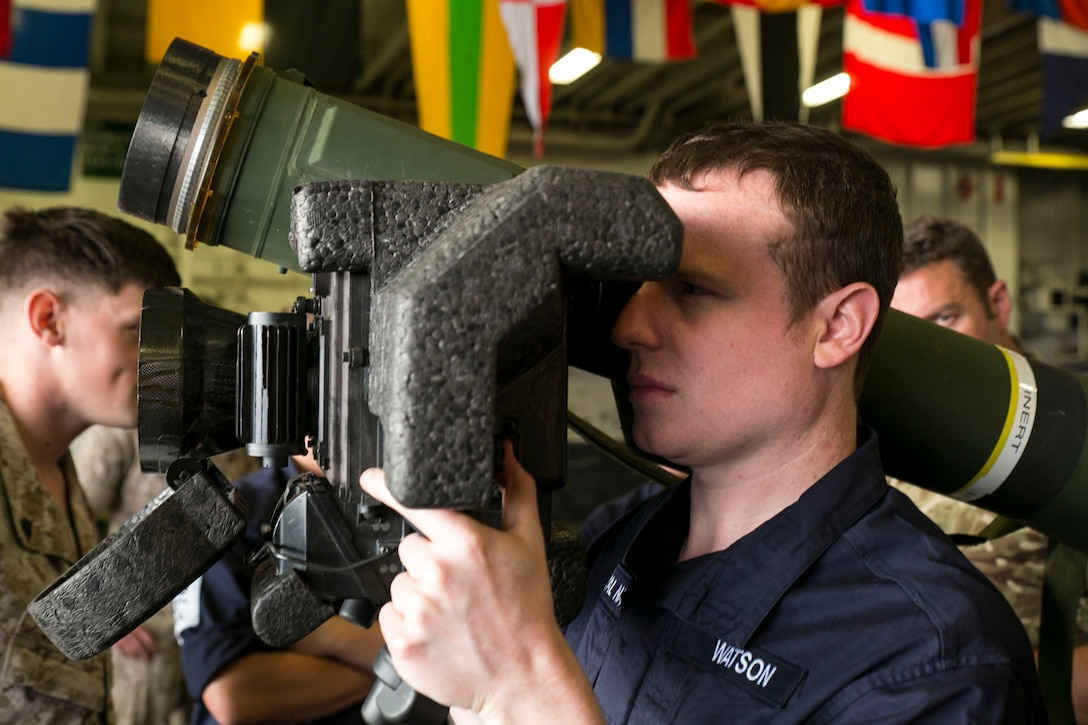 British Royal Navy Petty Officer Marine Engineer Elliott Watson, a refrigeration engineer with the HMS Lancaster, looks through the viewing display of a Javelin shoulder-fired anti-tank missile during a tour aboard the amphibious assault ship USS Wasp (LHD 1) while out at sea April 30, 2015. U.S. Marines and U.S. Navy Sailors with the 22nd Marine Expeditionary Unit from Marine Corps Base Camp Lejeune, N.C., participated in Navy Week 2015 in New Orleans April 23-29 and Fleet Week Port Everglades, Fla., May 4-10. The purpose of Navy Week was to showcase the strength and capabilities of the Navy-Marine Corps team through tours, static displays and community relations events, providing the public the opportunity to meet and interact with Marines and Sailors. (U.S. Marine Corps photo by Sgt. James R. Smith/Released)