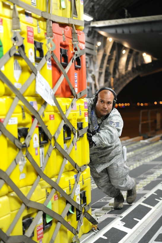 Staff Sgt. Ernie Jimenez, 452nd Aerial Port Support Flight, air transportation craftsman, helps load a pallet of equipment aboard a C-17 Globemaster III aircraft at March Air Reserve Base, Calif., April 26, 2015. The cargo includes sonar detection devices, heavy concrete cutting equipment, generators and more that will be used by an elite 57-person team, known as the Urban Search and Rescue Task Force 2 (CA-TF2), in support of earthquake emergency rescue operations in Nepal. (U.S. Air Force photo/Senior Airman Russell S. McMillan)