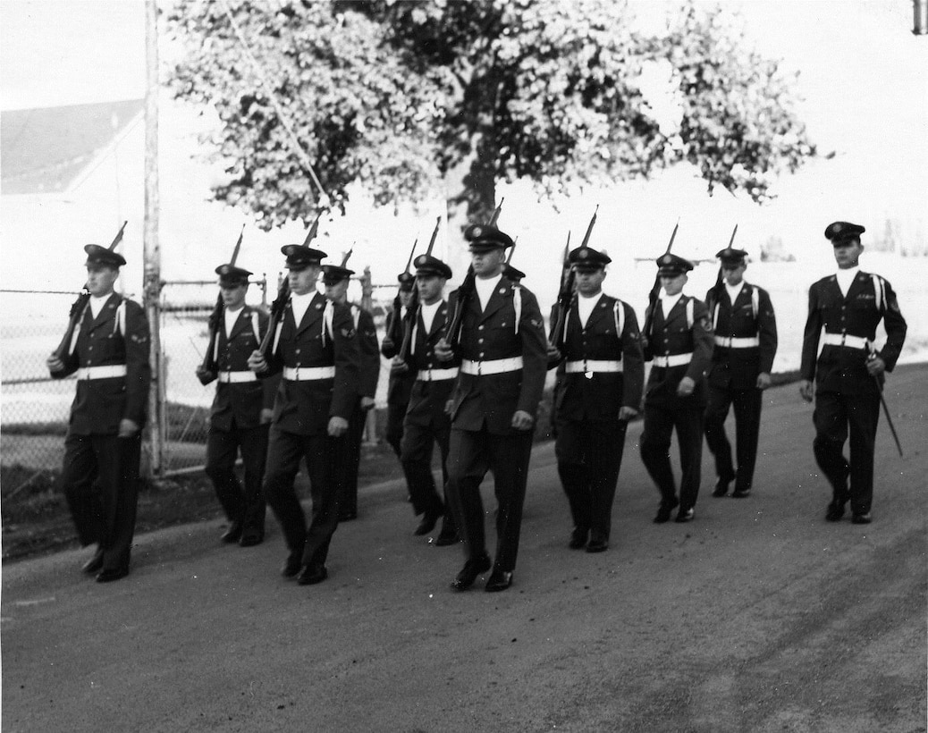 OreANG Precision Rifle Drill Team members march in the November, 1961, Veterans Day Parade.  The parade route went through a two-mile stretch of Southeast Portland.  (142FW History Archives)
