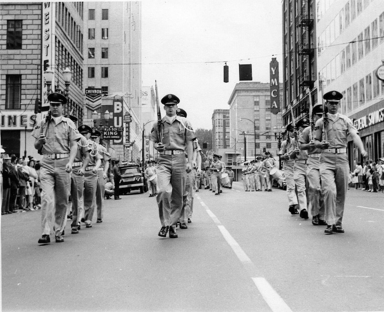 OreANG Precision Rifle Drill Team members march in khaki uniforms during the 11th Annual Armed Forces Day Parade in downtown Portland, May 20, 1961.  This picture was taken just before their precision maneuver in front of the official reviewing stand.  (142FW History Archives)