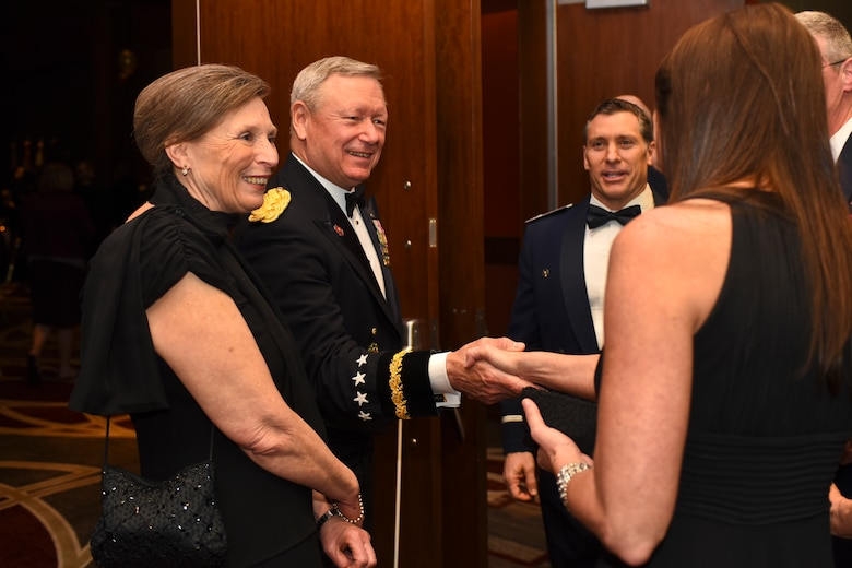 U.S. Army Gen. Frank J. Grass (middle left), Chief of the National Guard Bureau, and his wife, Patricia Grass (left), speak with attendees of the Ohio National Guard Association and Ohio National Guard Enlisted Association Spring Dinner Dance, Columbus, Ohio, April 25, 2015. Gen. Grass was the guest speaker at the event which is held annually for association members in both the Air and Army National Guard. (U.S. National Guard photo by Senior Airman Wendy Kuhn/Released)