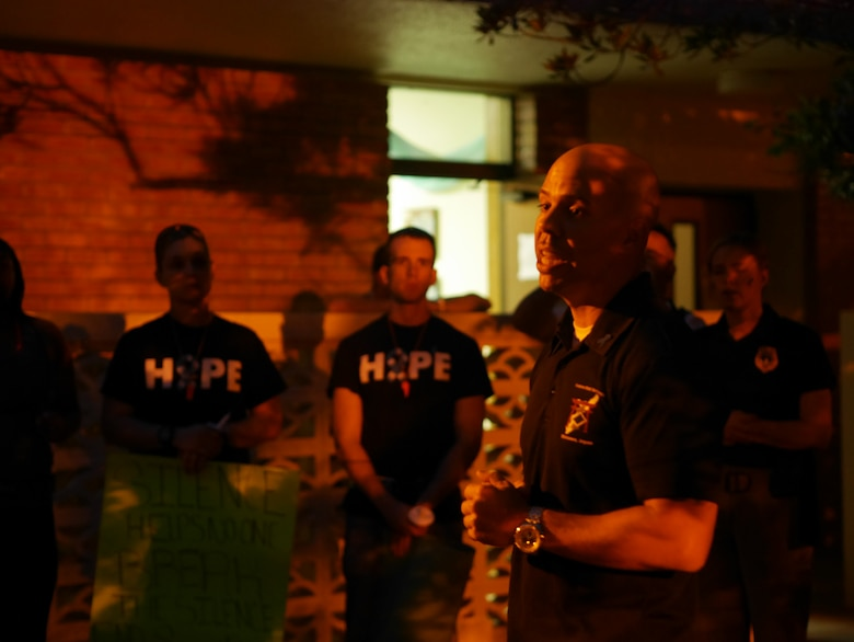 Master Sgt. Joseph Mageau, 18 Civil Engineer Group first sergeant, tells participants of Take Back the Night about his experience with sexual assault in the Chapel 2 courtyard on Kadena Air Base, Japan, May 1, 2015. During the event mandatory reporters explained the importance of leadership reporting sexual assault and their experiences of reporting. (U.S. Air Force photo/Senior Airman Omari Bernard)