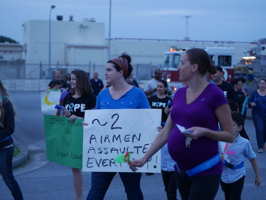Members of Team Kadena march and chant to raise awareness of sexual assault prevention during the Take Back the Night event on Kadena Air Base, Japan, May 1, 2015. Take Back the Night is a rally, a march and a time to reflect for the survivors of sexual assault. (U.S. Air Force photo/Senior Airman Omari Bernard)