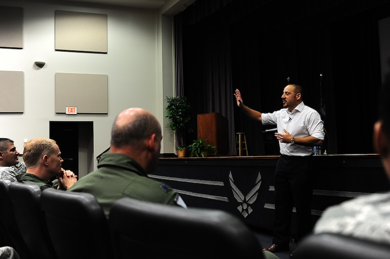 "Kevin Hines, author of ""Cracked, Not Broken,"" tells his story to members of the audience during his motivational speech April 28 in the Kaye Auditorium on Columbus Air Force Base, Miss. Hines attempted suicide at the age of 19 by jumping off of the Golden Gate Bridge in San Francisco, California. Hines survived the fall and now actively spreads the message of living mentally healthy to people around the globe. (U.S. Air Force photo/Airman 1st Class John Day)"