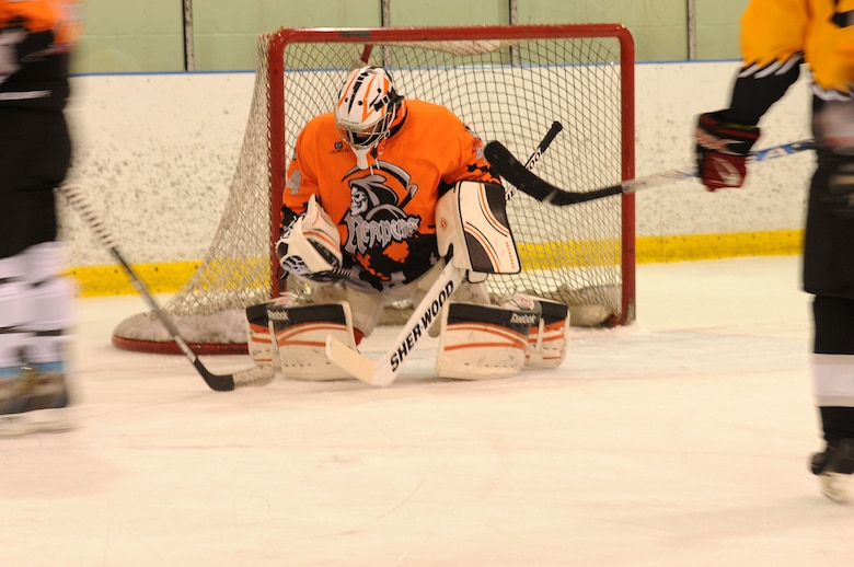 Senior Airman Jason Thomas, 111th Security Forces Squadron, Horsham Air Guard Station, Pennsylvania, is postured to make a save during the Face Off to Autism tournament at Ice Line Quad Rinks, April 25, 2015, in West Chester, Pennsylvania. Thomas formed the Guard-based hockey team, who practiced and played together for the first time during the tournament. (U.S. Air National Guard photo by Tech. Sgt. Andria J. Allmond/Released)