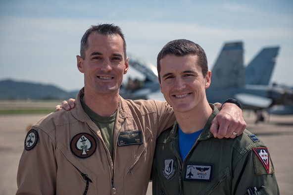 "U.S. Marine Corps Capt. Jarrod ""Bluto"" Allen, Marine All Weather Fighter Attack Squadron 225 F/A-18 Hornet pilot, and U.S. Air Force Capt. Jacob ""Apollo"" Allen, 35th Fighter Squadron F-16 Fighting Falcon pilot, pose for a photo together during exercise Max Thunder 15-1 at Gwangju Air Base, Republic of Korea, April 17, 2015. (U.S. Air Force photo by Senior Airman Taylor Curry/Released)"