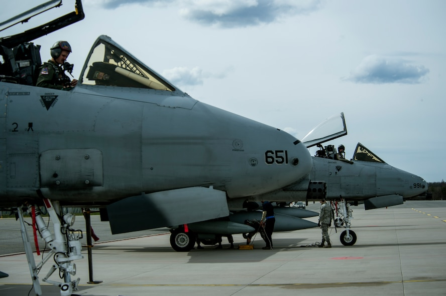 U.S. Air Force A-10 Thunderbolt II attack aircraft pilots wait to climb out of their aircraft after landing at Ämari Air Base, Estonia, May 1, 2015. About 66 Airmen and support equipment from the 355th Fighter Wing at Davis-Monthan Air Force Base, Arizona, and the 52nd Fighter Wing at Spangdahlem Air Base, Germany, will support the deployment in Estonia. (U.S. Air Force photo by Senior Airman Rusty Frank/Released)