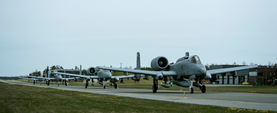 A-10 Thunderbolt II attack aircraft taxi on the flightline May 1, 2015, at Ämari Air Base, Estonia. The aircraft are deployed to Estonia in support of Operation Atlantic Resolve to bolster air power capabilities while underscoring the U.S. commitment to European security and stability. (U.S. Air Forces photo by Senior Airman Rusty Frank/Released)